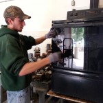 Photo of man demanufacturing an oven