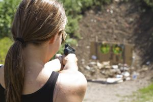 Photo of a woman shooting a handgun at the Spring Run shooting range