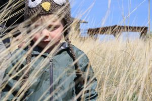 Photo of a young boy in prairie grass