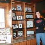 Photo of Timothy Frostestad in front of his insect collection