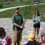 Photo of naturalists giving a program in the outdoor amphitheater