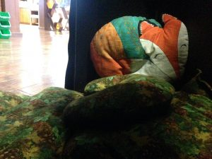 Photo of leafy pillows and a fox pillow inside the fox burrow