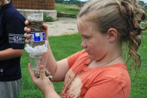 Photo of a girl doing a water experiment