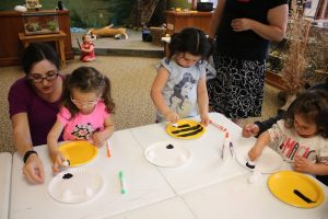 Photo of kids making a bee craft