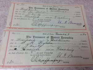 Photo of a paycheck from 1895