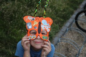 Photo of a boy with a butterfly mask