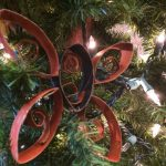 Photo of a butterfly ornament in a tree