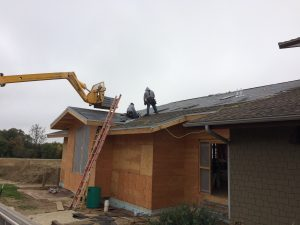 Photo of shingles being put up