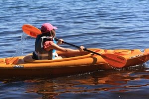 Photo of a child kayaking