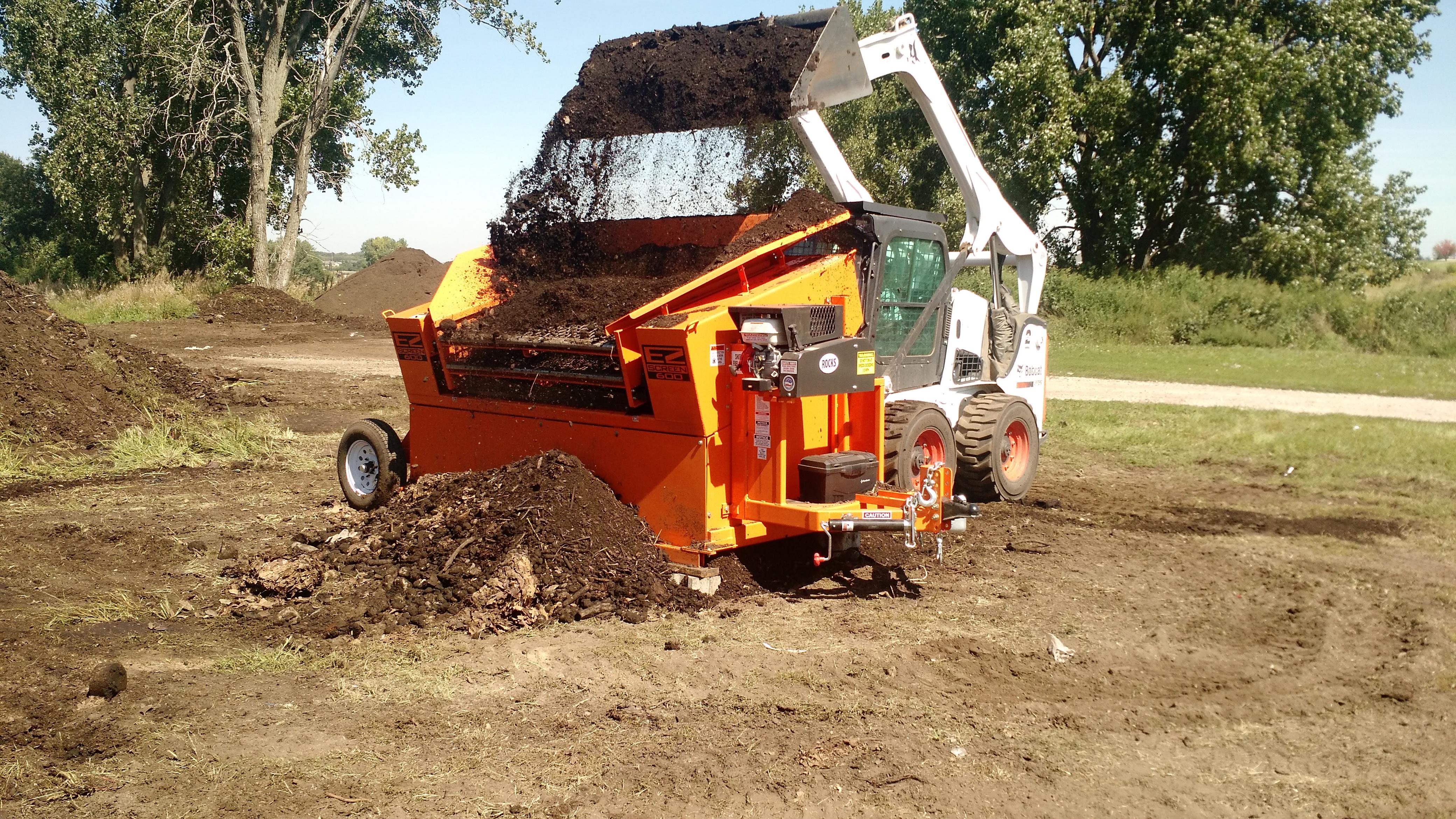 Photo of Bobcat sifting compost