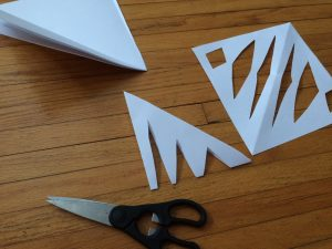 Photo of paper triangles being cut