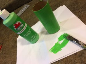 Photo of a toilet paper tube painted green