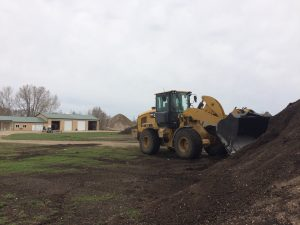 Photo of a tractor moving compost