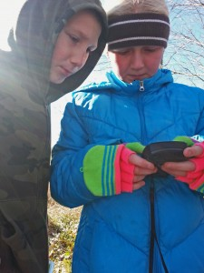 Photo of children looking at a GPS unit