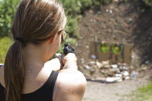 Photo of a woman shooting a handgun at the Spring Run shooting range