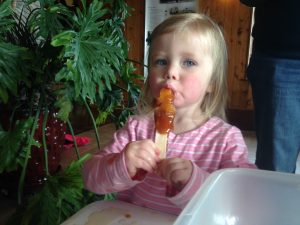Photo of a child eating maple taffy