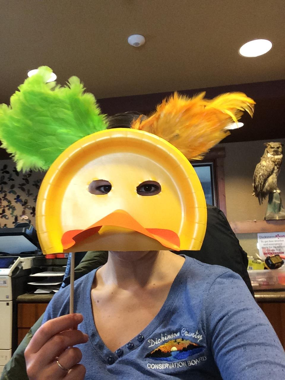 Photo of a person holding up a duck mask & Make your own duck mask from a paper plate u2013 Dickinson County ...
