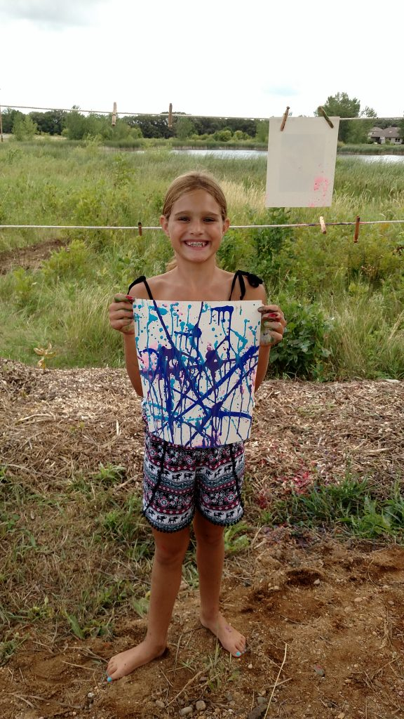 girl with squirt gun painting