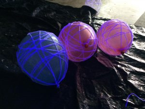 Photo of balloons covered in yarn