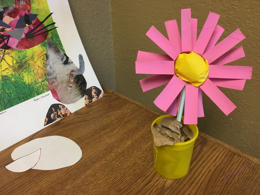 Photo of a flower made from scrap paper items