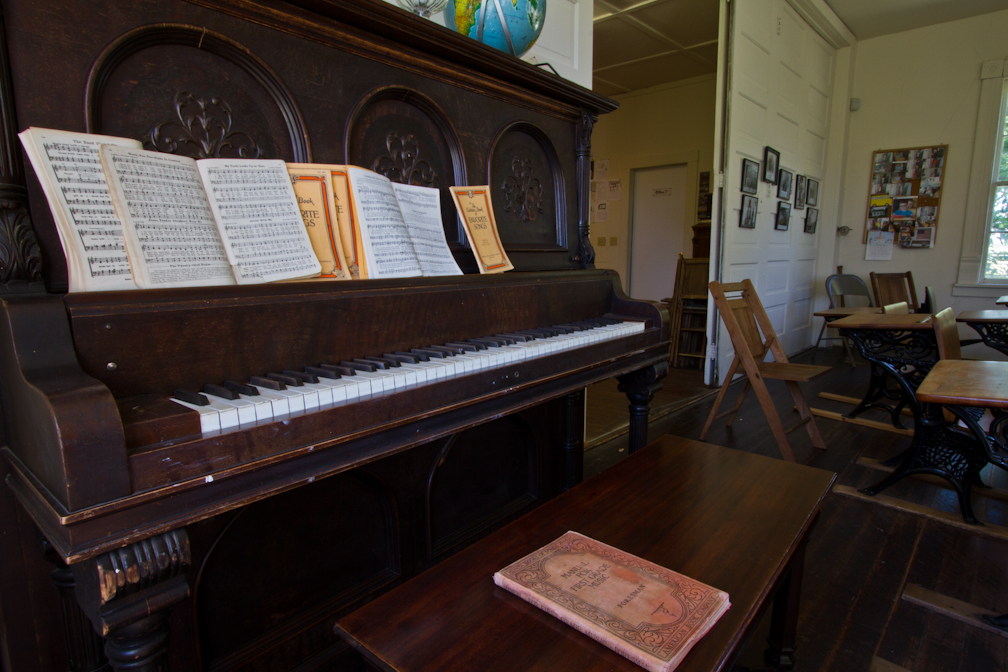 Photo of piano in Westport Schoolhouse