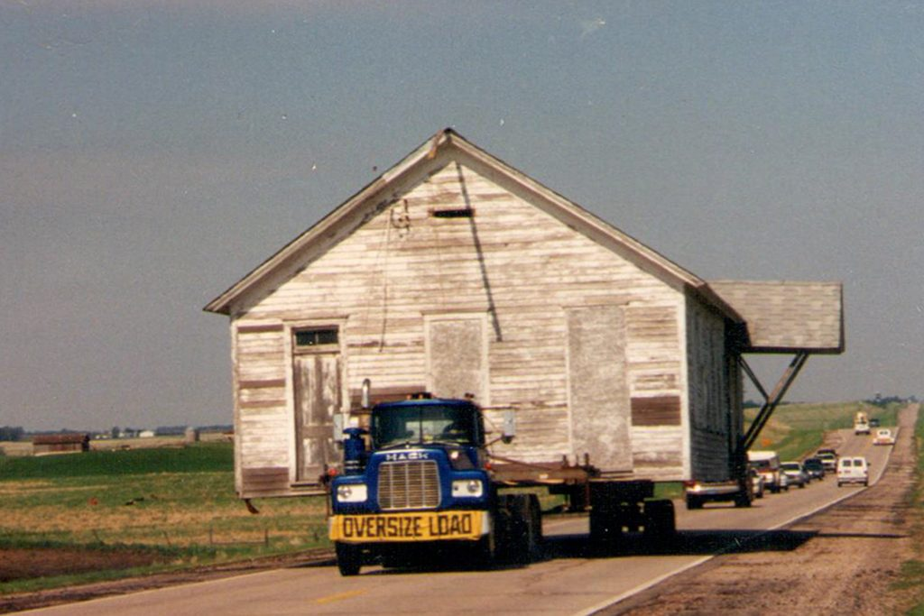 Photo of schoolhouse moving on a truck