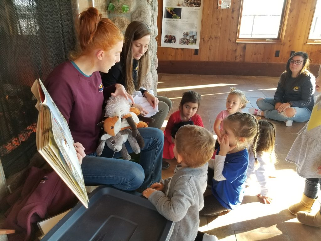 Photo of naturalists reading a story