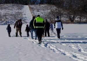 people walking through the snow