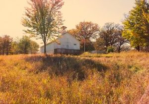 Photo of Westport Schoolhouse with a red tint